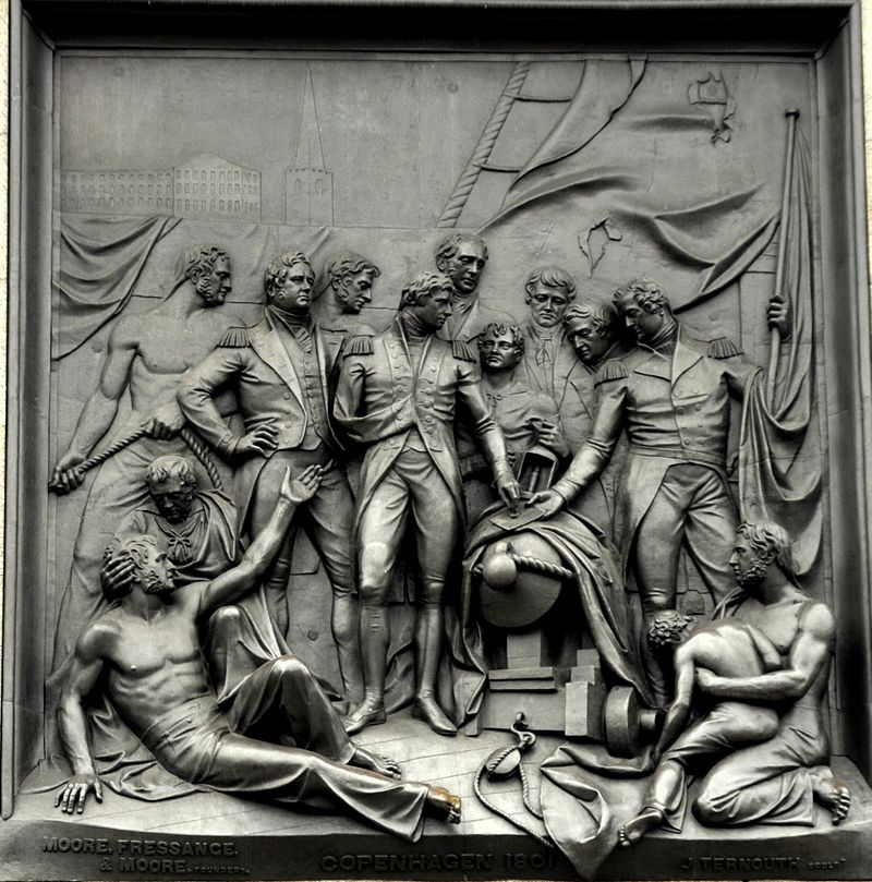 a bronze metal picture from nelsons column at trafalgar square in london showing the battle of copenhagen