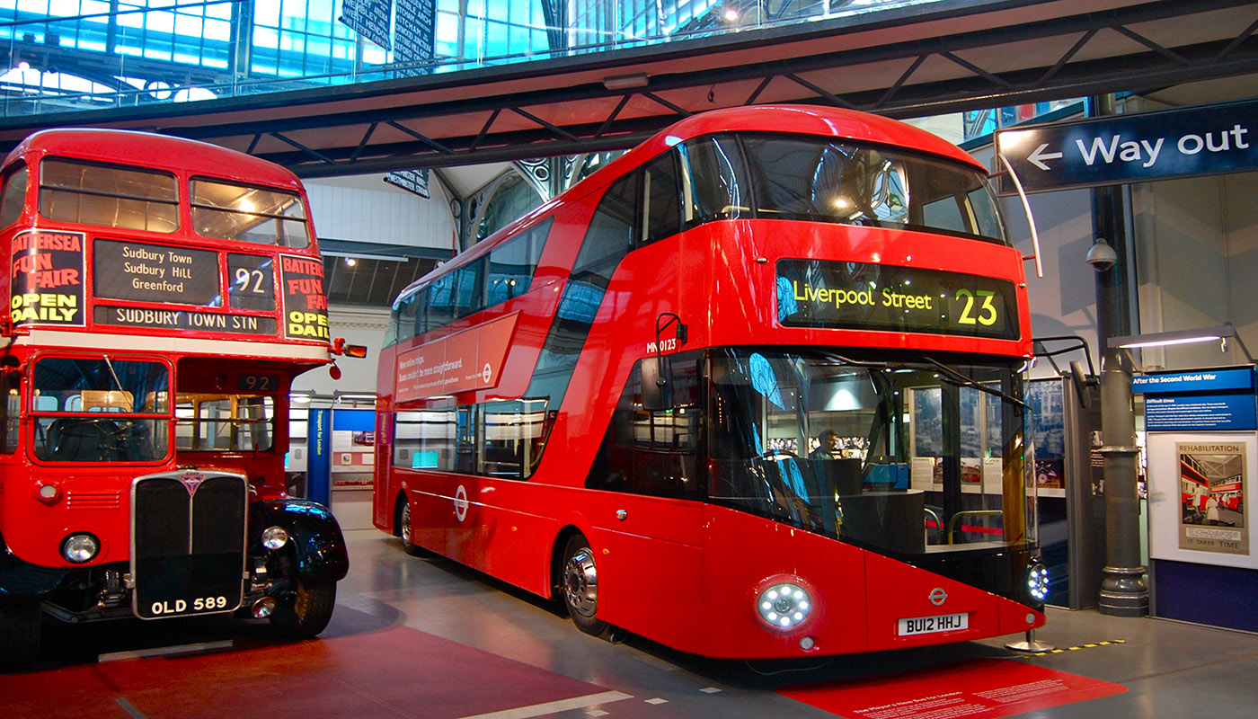 a couple of double decker red buses in london