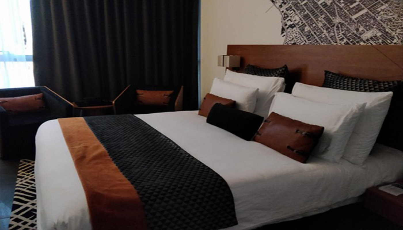 inside look and a king size bed in a TRYP VYP King Room in tryp by wyndham hotel in dubai