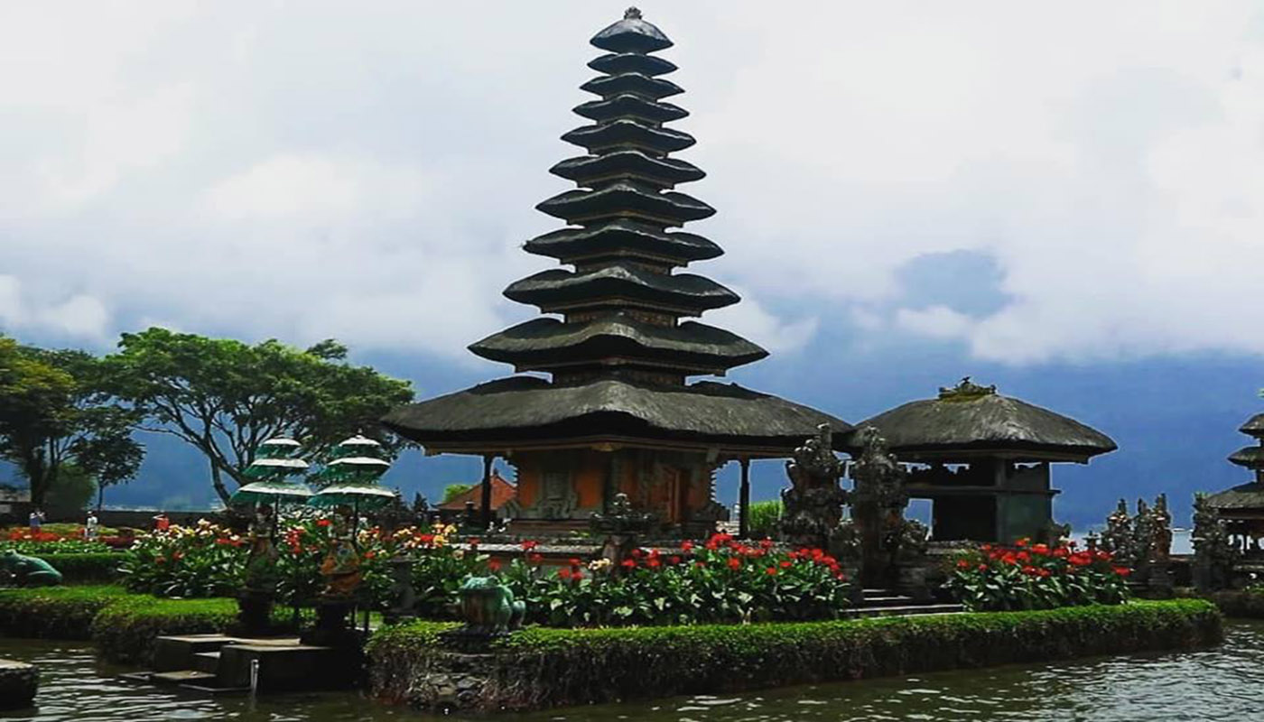 a temple with high roof on bratan lake in bali