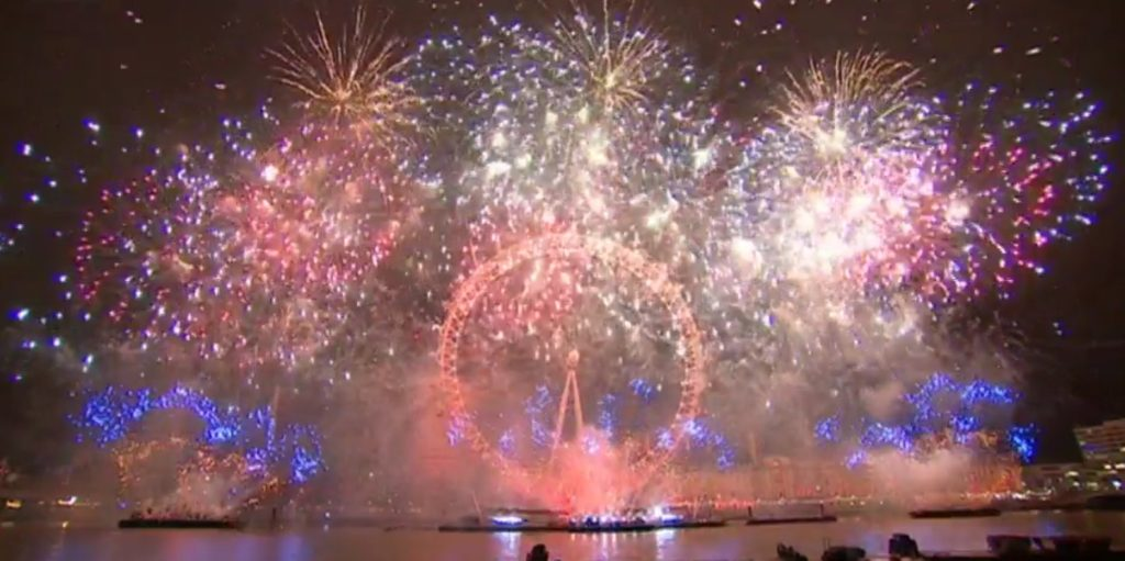 london eye fully surrounded by fireworks in different colors during the new years eve firework show in london 2019
