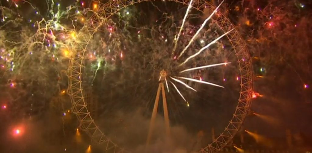close up on london eye during the fireworks for new years eve 2019 while forming a clock