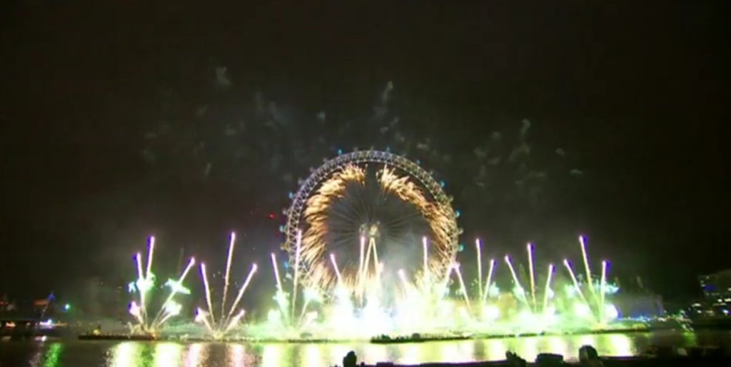 london eye pictured from the opposite shore with fireworks all around during the new years eve show