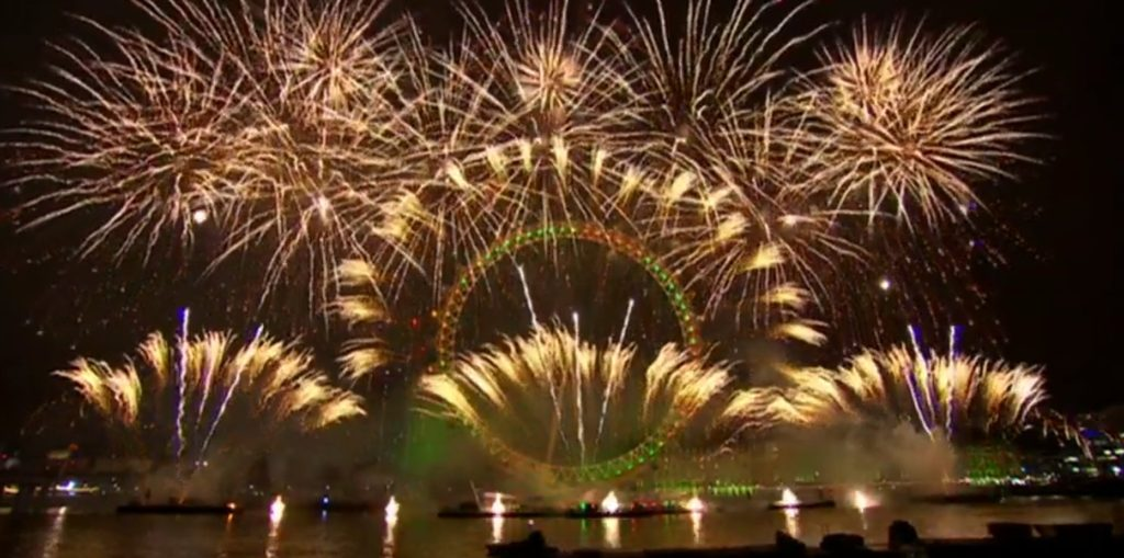 london eye fully in fireworks all around in green and white during the new years eve fireworks show 2019