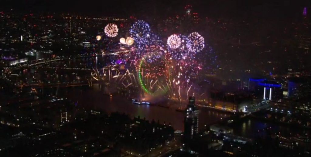 London eye surrounded by fireworks on new years eve fireworks show view from the top