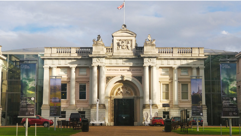 the building of the national maritime museum pictured from the front with the british flag on top