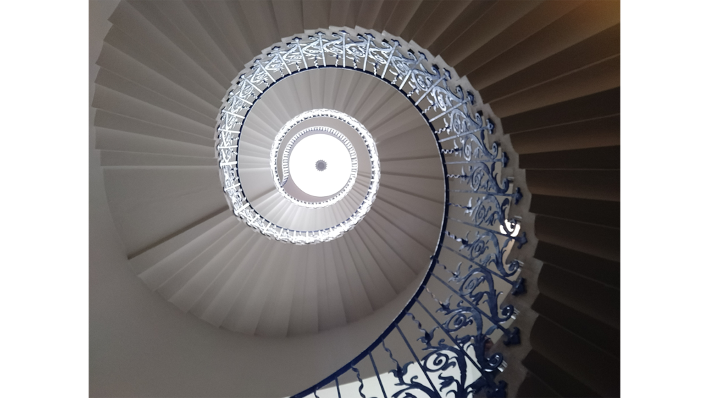 a spiral staircase pictured from the ground floor