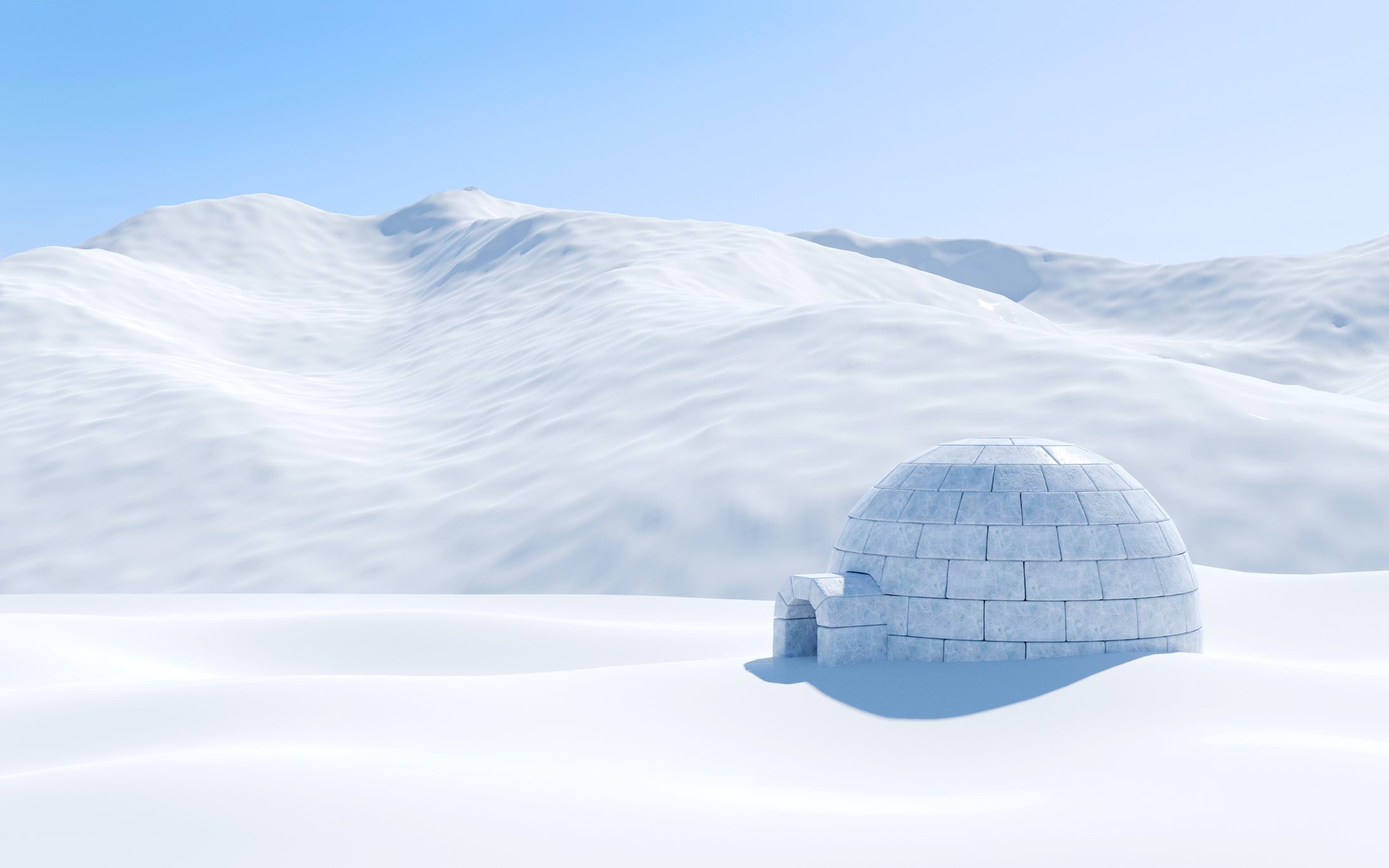 full built igloo with a snow hill in the background