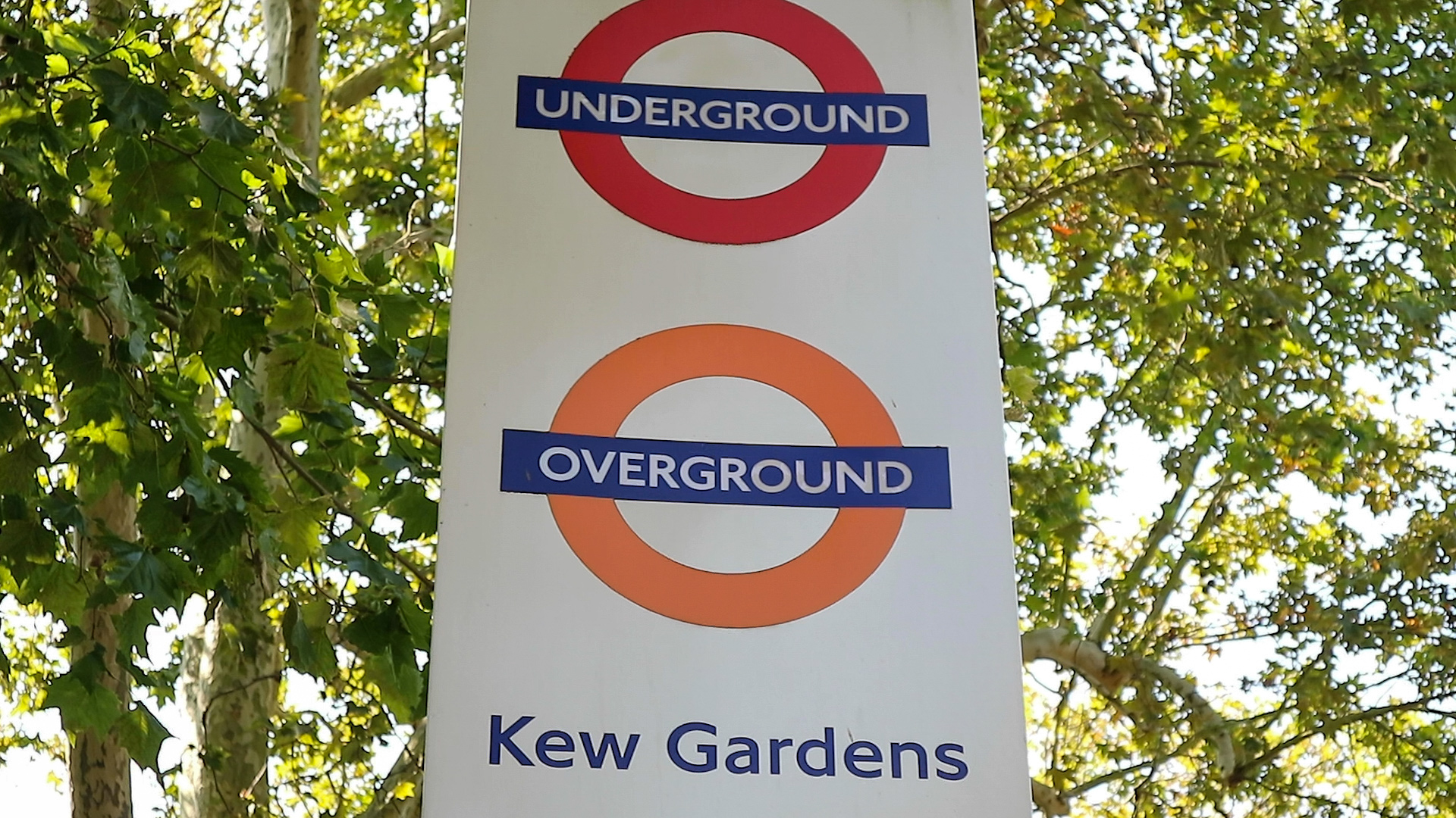 A sign showing the Kew Gardens Stop of the London Underground