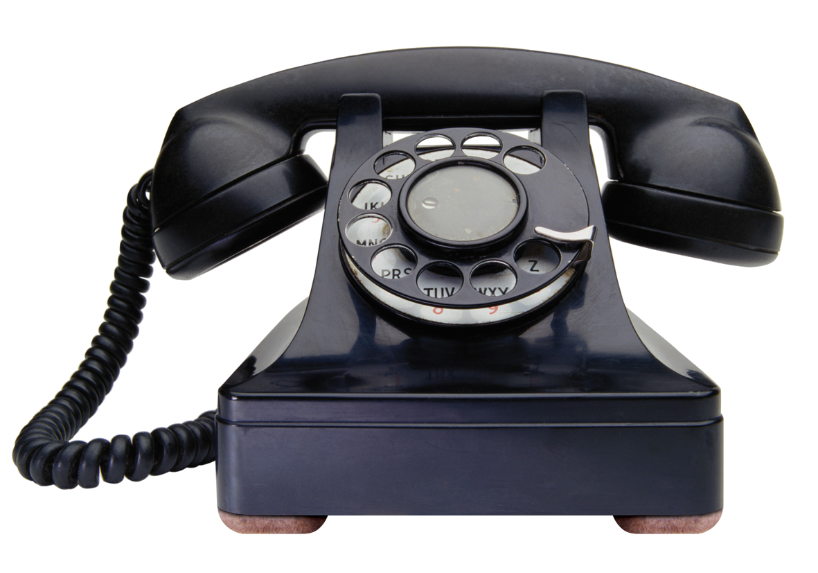 an old black phone with a ring dial