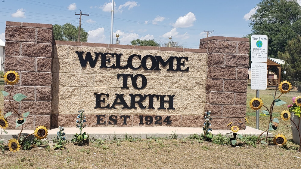 Welcome to Earth Texas est 1924 welcoming sign from stone and sunflowers in Texas USA